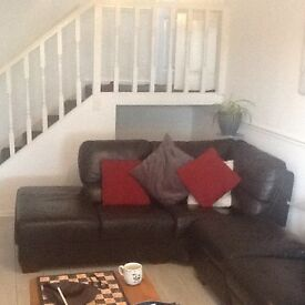 2 seater sofa and storage pouffe