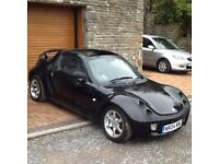 2004 Smart Roadster Automatic in black. It has an electric roof, electric Windows and alloy wheels.