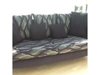 3 seater sofa with reverseable back cushions colour black and grey very good condition