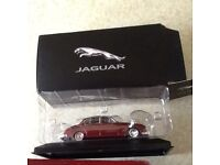Two jaguar cars one police mk11police car white and one jaguar mk2red