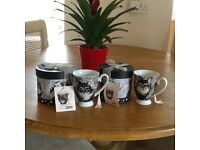 Two Oscar and Bromley black and white cat mugs