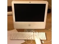 Apple iMac with wired keyboard and mouse