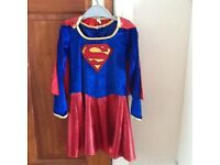 Rubies Supergirl dressing up outfit, cape, belt and boot covers.