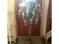 Artificial tree with pink blooms