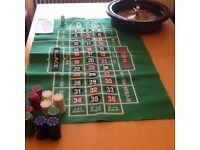 Roulette Wheel, chips and mat