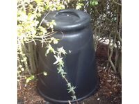 Round, black composter bin, side opening and lidded top. 330 litre capacity