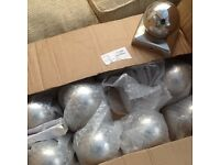 Stainless steel fence toppers, 11 in total.