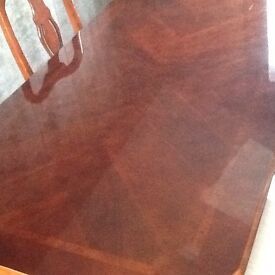 Lovely polished table & 4 chairs