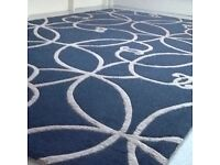 Designer black and gold rug