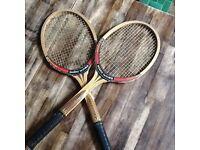 Retro John McEnroe pair of wooden tennis racquets.