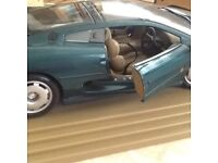 Model of Jaguar XJ220 on plastic base, in very good condition.