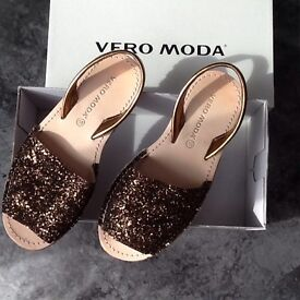 Brand new with box - bronze sandals in a size 5