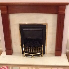 Gas fire with marble surround and wood mantle