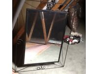 Black metal framed mirror