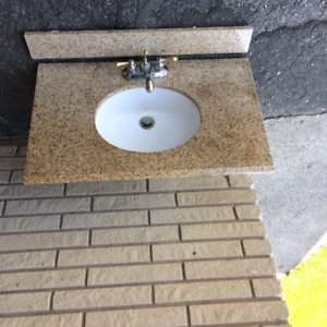 Granite bathroom counter, sink and taps