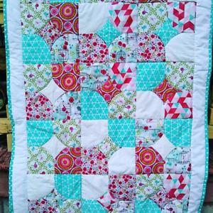 Handmade baby crib quilt.