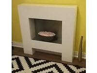 Electric fire and surround. Attractive feature in good condition. £60 ono.