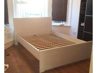 Ikea white BRUSALI bed frame, near perfect condition. 2 storage drawers included!