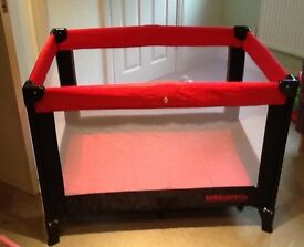 Travel cot with additional mattress.