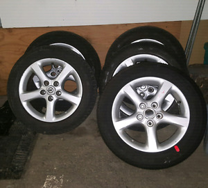 Nissan  mags  with tires(5)