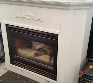 Gas fireplace and frame $ 150 or BO