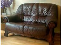 brown leather sofa and two armchairs