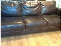 3 seater leather sofabed in excellent condition £235 .
