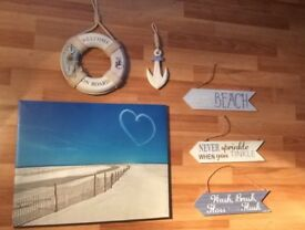 Nautical bathroom canvas and hanging ornaments