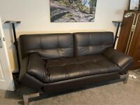 Like new - Sofa Bed. Broawn Leather. Folds out. Arms fold down flat for bed extending.