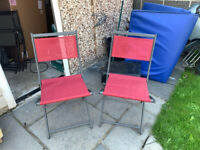 2 x red garden chairs