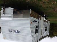Roulotte à louer sur terrain de camping à 15 minutes de percé