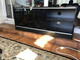 TV STAND WITH SLIDING TINTED GLASS DOORS. 120L X 14W- 46H