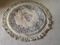 Cream and blue circular Chinese rug