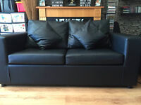 Black faux leather metal action sofa bed