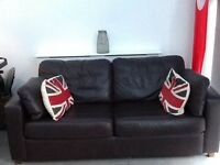Excellent condition Brown Leather two seater sofa bed.
