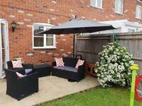 Rattan garden furniture set with parasol