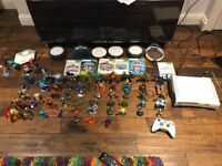 Xbox 360 console with Skylanders characters and portals games
