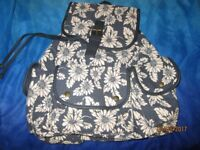 DAISY PATTERNED BACKPACK FROM CLAIRES NEW measures 16 x 11 inch