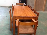 Pine table and eight chairs
