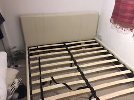Double bed in beige faux leather