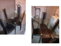 COMPACT GLASS AND CHROME DINING TABLE WITH 4 HIGH BACKED BLACK AND CHROME CHAIRS MODERN DESIGN