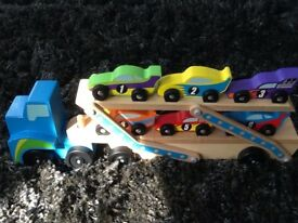 Melissa & Doug Mega Race-Car Carrier -With 6 Unique Race Cars