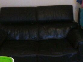 2 brown leather couches