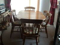 Polished pine table and chairs