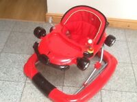 A 2 in 1 convertible walker/ rocker in Ferrari Red-used & in excellent condition-washed padded seat