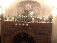 Solid wooden mantle from brick fireplace.
