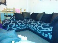 Black and silver corner sofa
