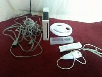 Nintendo Wii with remote and wheel