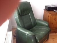 Two green leather armchairs