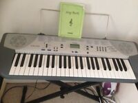 Casio keyboard with stand and booklet good condition
